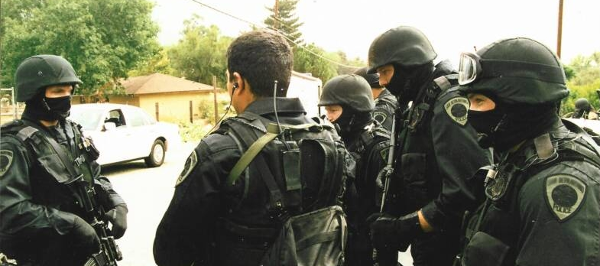 SWAT Prepares To Raid Home